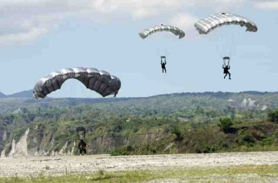filipino special forces in low-level air drop training exercise