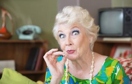 Excited Caucasian senior woman in green smoking marijuana